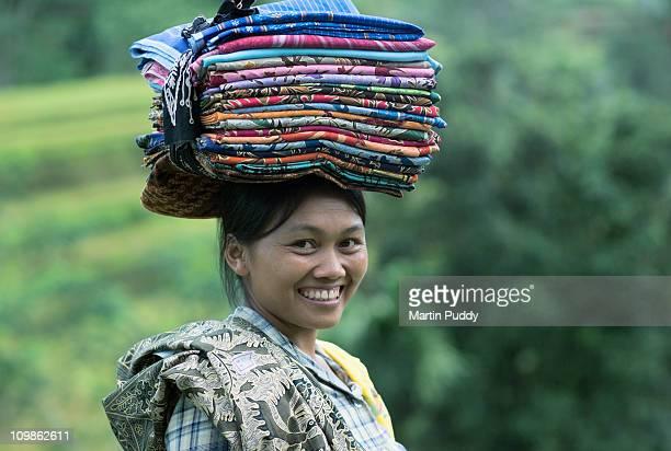 woman selling batik sarongs in rice terraces