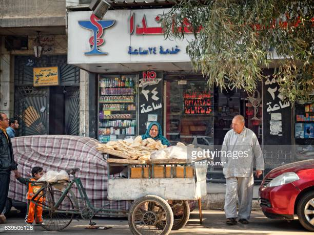 Woman selling bread in the street of Cairo, Egypt