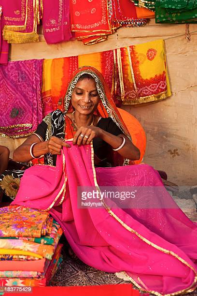 Woman selling colorful fabrics