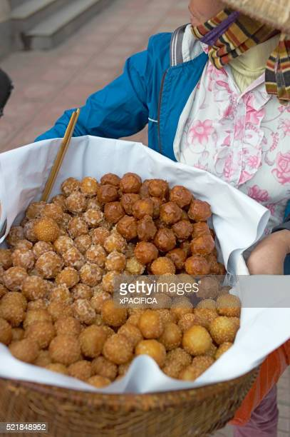 A woman selling fried food