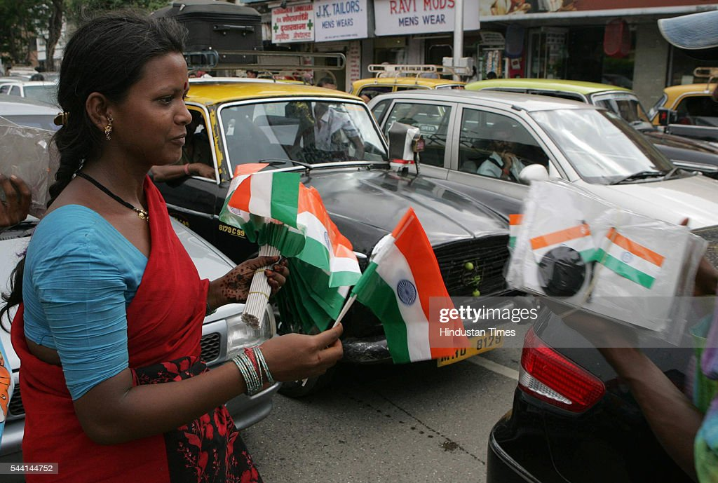 A woman selling national flags for the forthcoming Independence Day celebration in Mumbai.