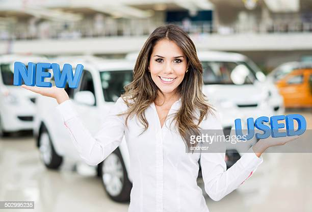 Woman selling new and used cars