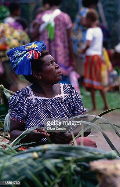 Woman selling shellfish at Rabaul Market.