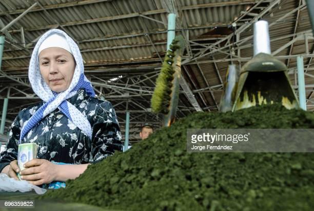 SHAHRISABZ QASHQADARYO UZBEKISTAN Woman selling sniffing tobacco in the Chorsu Bazar