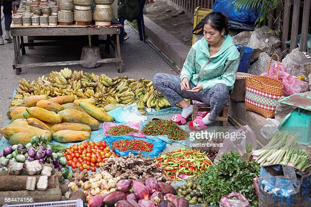 Woman selling vegetables in the market in Luang Prabang