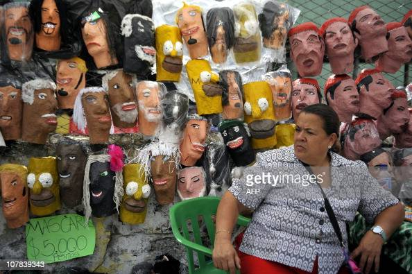 A woman sells 'Ano viejo' doll heads in the streets of Cali department of Valle del Cauca Colombia on December 31 2010 These dolls made of cardboard...