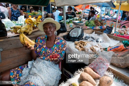 Woman sells bananas and fruits at market