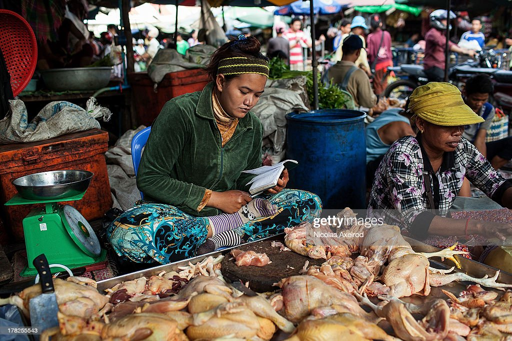 A woman sells chickens at the Kandal Market in central Phnom Penh on August 25, 2013 in Phnom Penh, Cambodia. Cambodia has seen the worst out break of Avian influenza H5N1 since the disease was first identified, so far this year 17 cases have been report, 10 of which have been fatal.