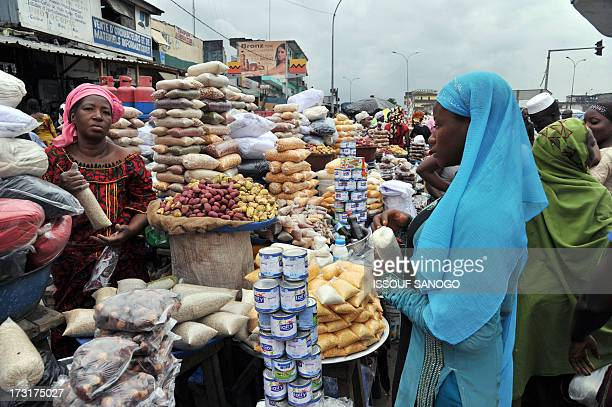 A woman sells dates and cereals in a street market in Abobo suburb of Abidjan on July 9 on the first day of the Islamic holy month of Ramadan in...