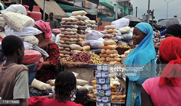 A woman sells dates and cereals in a street market in Abobo suburb of Abidjan on July 9 2013 on the first day of the Islamic holy month of Ramadan in...
