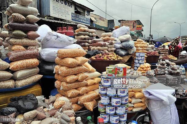 A woman sells dates and cereals ina street market in Abobo suburb of Abidjan on July 9 on the first day of the Islamic holy month of Ramadan in...