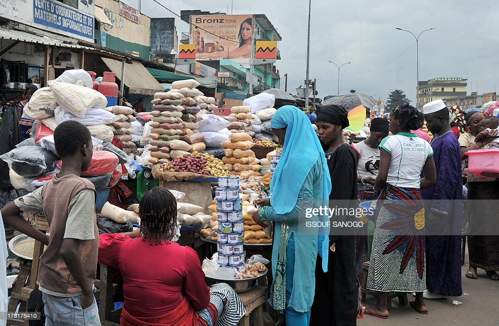 A woman sells dates and cereals ina street market in Abobo, suburb of Abidjan on July 9, 2013 on the first day of the Islamic holy month of Ramadan in Abidjan.