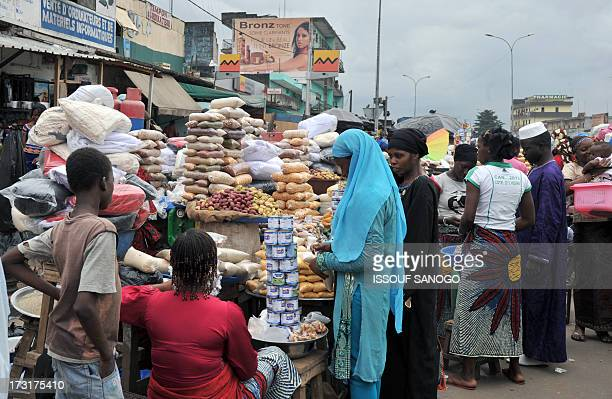 A woman sells dates and cereals ina street market in Abobo suburb of Abidjan on July 9 2013 on the first day of the Islamic holy month of Ramadan in...