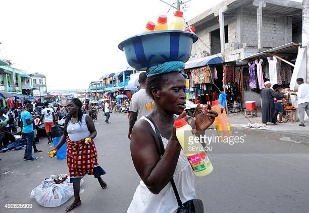A woman sells drinks in a street of Monrovia on May 7 2014 Liberia is entering its second decade of fragile peace after one of the bloodiest civil...