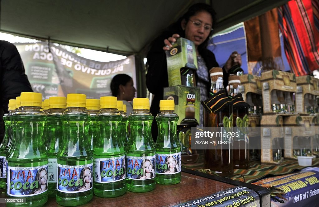 A woman sells drinks made out of coca leaves at her stall in a square of La Paz, on March 12, 2013 during the celebration of the first National year of Coca Chewing (acullicu). AFP PHOTO/Aizar Raldes