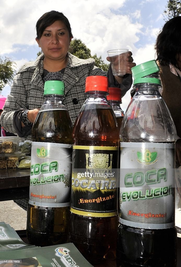 A woman sells energizing drinks made out of coca leaves at a stall in a square of La Paz, on March 12, 2013 during the celebration of the first National year of Coca Chewing (acullicu). AFP PHOTO/Aizar Raldes