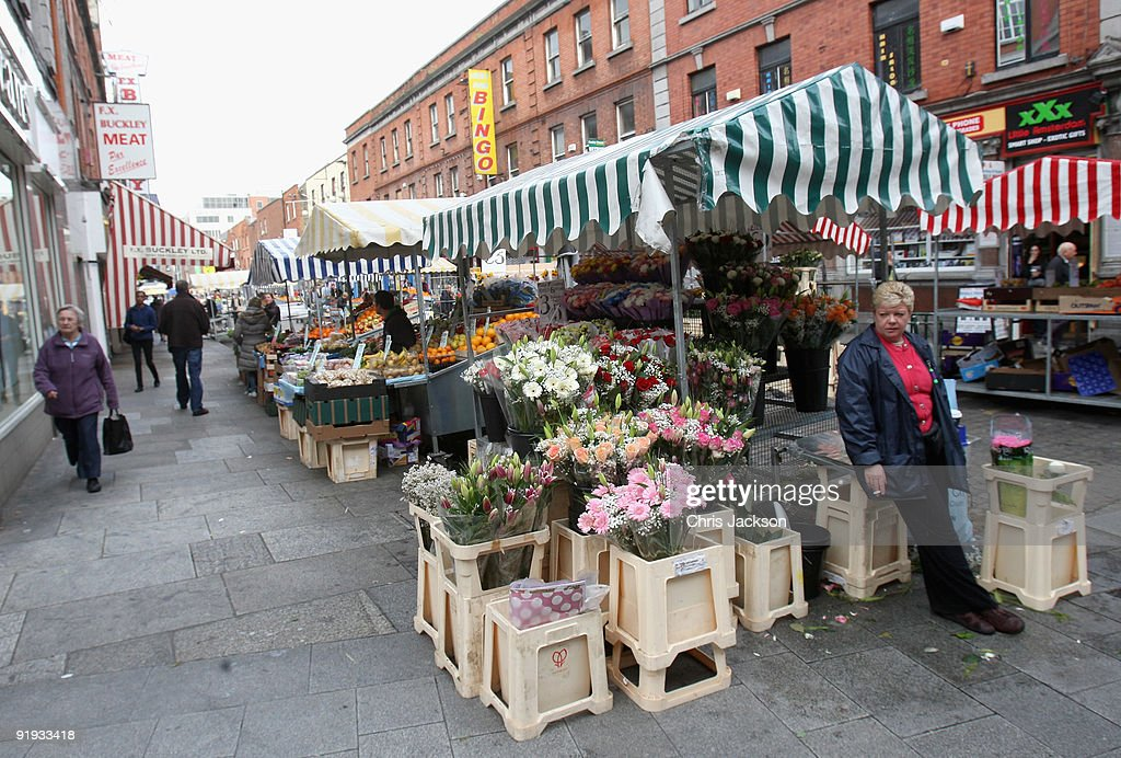 A woman sells flowers at a market stall on October 15, 2009 in Dublin, Ireland. Dublin is Ireland's capital city, located near the midpoint of Ireland's east coast, on the River Liffey. It is a vibrant city with a thriving music scene and has been voted one of the top 25 cities of the world to live in. Irish President Mary McAleese signed the European Union's Lisbon treaty today, two weeks after voters approved the Lisbon Treaty in a controversial referendum.