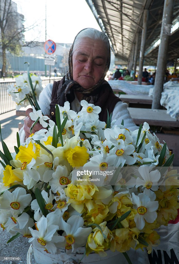 A woman sells flowers in the city centre on April 17, 2013 in Timisoara, Romania. Romania has abandoned a target deadline of 2015 to switch to the single European currency and will now submit to the European Commission a programme on progress towards the adoption of the Euro, which for the first time will not have a target date.