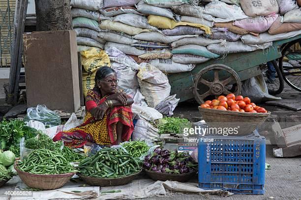 A woman sells fresh fruits on a Mumbai street