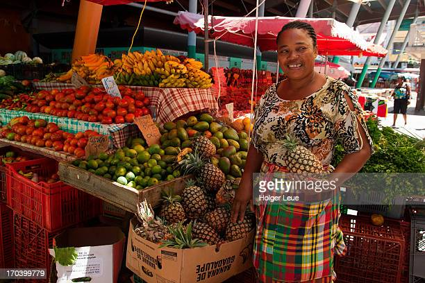 Woman sells fruit and vegetables at market