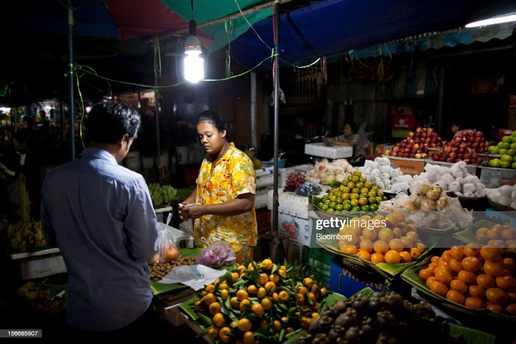 A woman sells fruit at Kandal Market in downtown Phnom Penh, Cambodia, on Saturday, Nov. 17, 2012. U.S. President Barack Obama arrives in Phnom Penh later today to join the Association of Southeast Asian Nations (Asean) East Asia Summit, which also includes leaders from Japan, South Korea, India, Russia, Australia and New Zealand. Photographer: Will Baxter/Bloomberg via Getty Images
