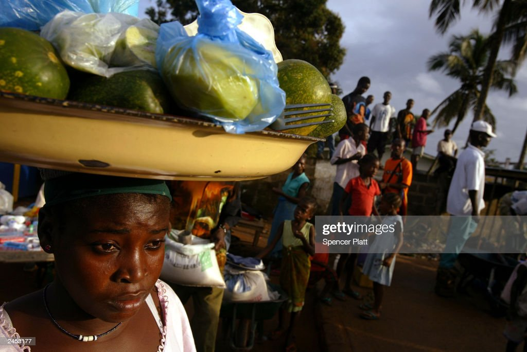 A woman sells fruit on a street corner September 1, 2003 in Monrovia, Liberia. Thousands of Liberians have been displaced by war and are living hand to mouth. After a month of heavy fighting, the Liberian government has signed an agreement with the two main rebel groups. In Ghana, Liberian government and rebel delegates have selected businessman Gyude Bryant to head Liberia's interim post-war administration. Liberia's former president, Charles Taylor, went into exile August 11, 2003.