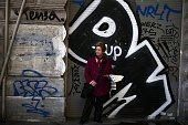 A woman sells lottery tickets in front of a closed store in the center of Athens on November 20 2014 Finance Minister Gikas Hardouvelis is set to...