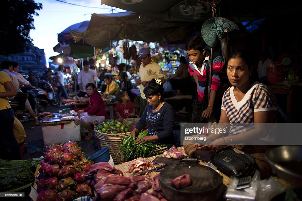 A woman sells meat at Kandal Market in downtown Phnom Penh, Cambodia, on Saturday, Nov. 17, 2012. U.S. President Barack Obama arrives in Phnom Penh later today to join the Association of Southeast Asian Nations (Asean) East Asia Summit, which also includes leaders from Japan, South Korea, India, Russia, Australia and New Zealand. Photographer: Will Baxter/Bloomberg via Getty Images