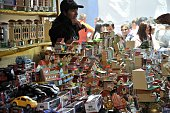 A woman sells miniature goods during the inauguration of the Alasitas a festivity in honour of the Ekeko the Aymara God of Abundance in La Paz on...