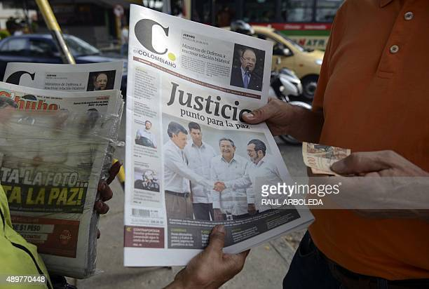 A woman sells newspapers on a street in Medellin Antioquia department Colombia on September 24 in the aftermath of the agreements signed by the...