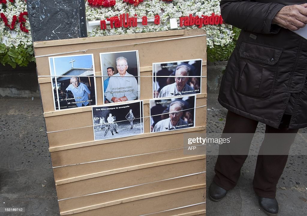 A woman sells pictures of French priest Pierre Dubois during his funeral in Santiago, on October 1, 2012. Dubois, who lived in the church of 'Nuestra Senora de la Victoria' in southern Santiago's La Victoria slum which was emblematic of the struggle against the dictatorship of Augusto Pinochet (1973-1990), died on September 28 at the age of 80. AFP PHOTO/Claudio SANTANA