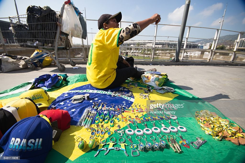 A woman sells souvenirs at the Maracana stadium in Rio de Janeiro, Brazil as the preparations for the Olympics continue on June 25, 2016. More than 10,500 athletes from 206 National Olympic Committees (NOCs), including first time entrants Kosovo and South Sudan, are scheduled to take part.