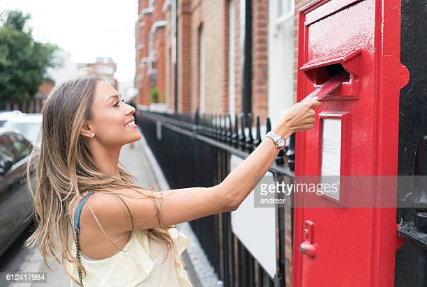 Woman sending letter through the mail