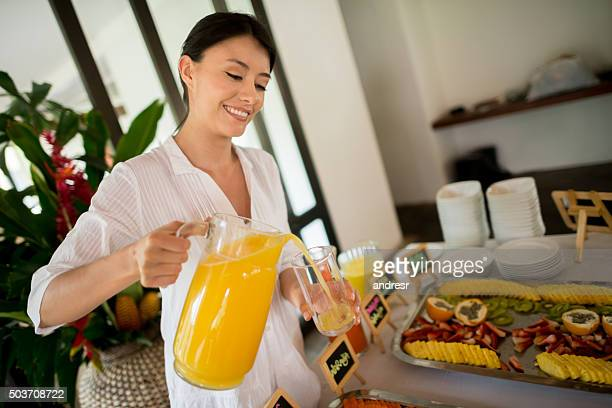 Woman serving breakfast at a hotel