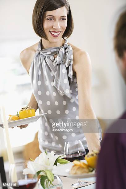 Woman serving entrees