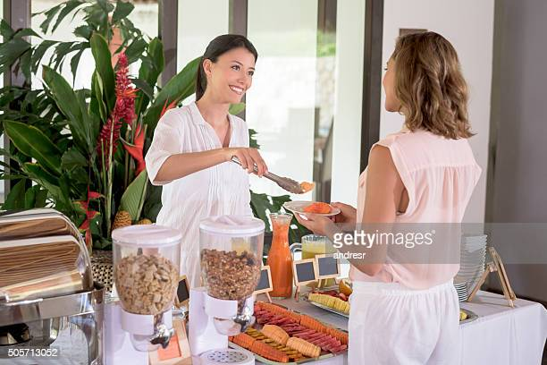 Woman serving food at a buffet