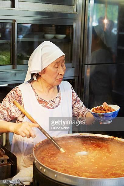 Woman serving food, Outer Fish Market, Tsukiji