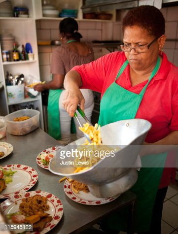 Woman serving food : Stock Photo