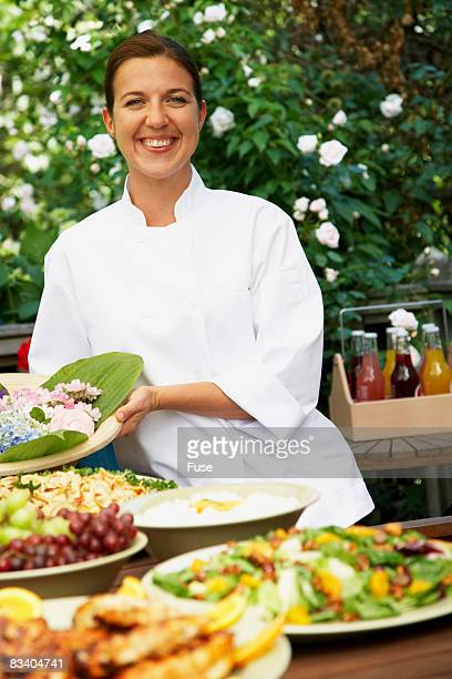 Woman Serving Outdoor Meal