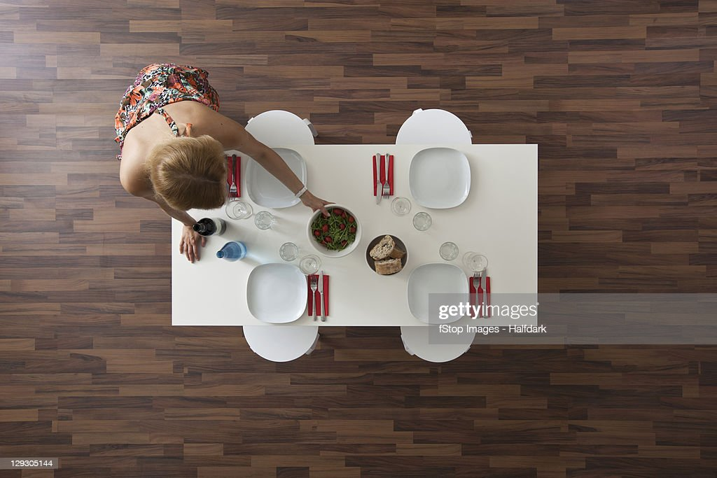 Dinner Table Overhead View : ... table woman setting dining room table for dinner party overhead view