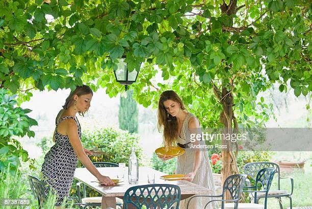 Woman setting table in garden