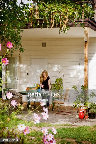 Woman setting table on porch