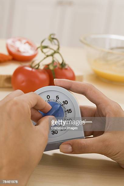 Woman setting timer for ten minutes