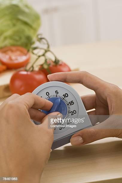 Woman setting timer