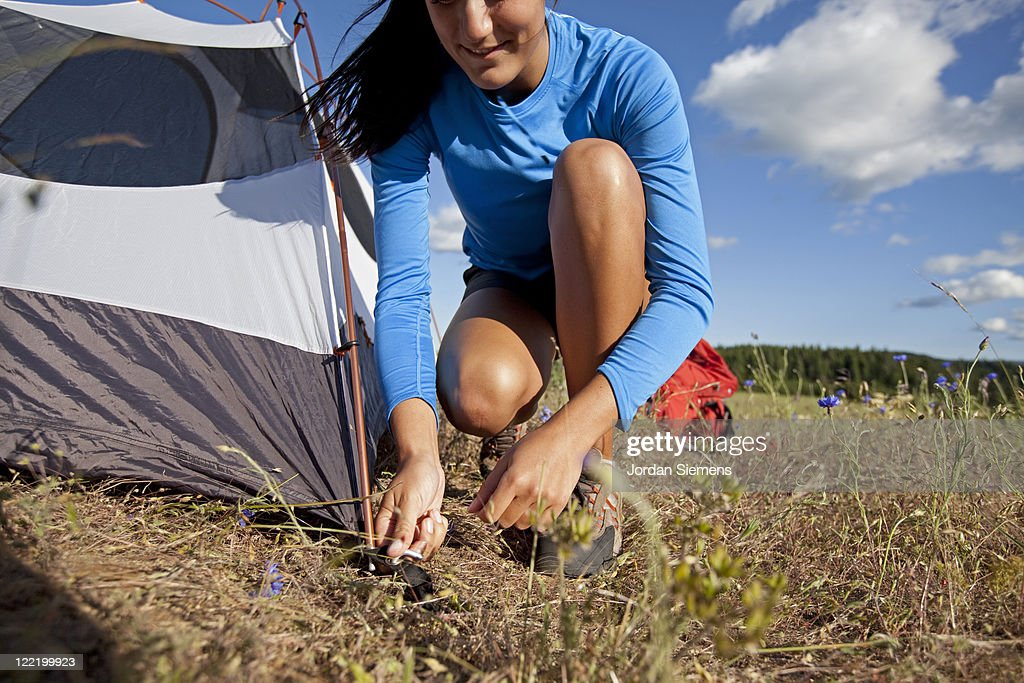 A woman setting up camp. : Stock Photo