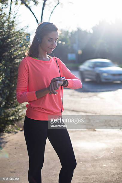 Woman setting up the smart watch for running