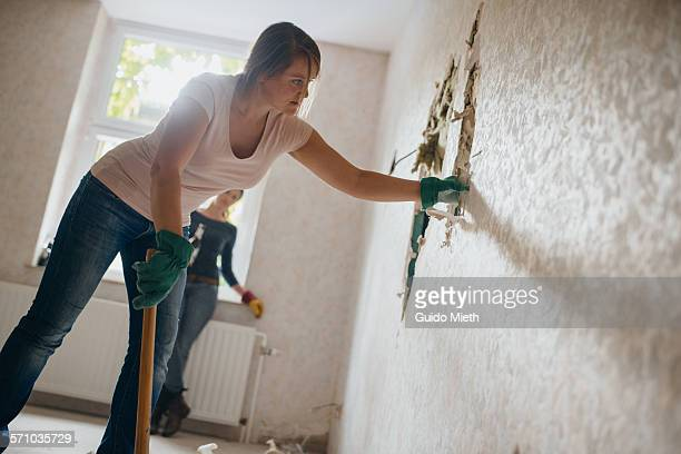 Woman severing old wall.
