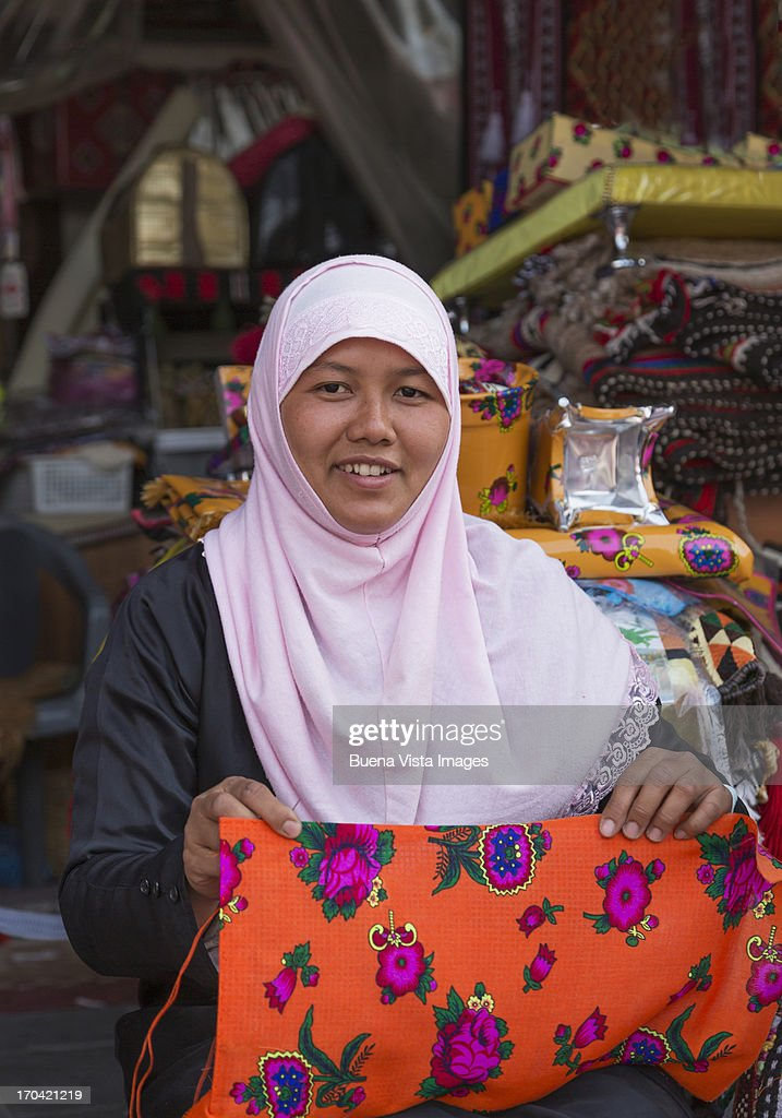 Woman sewing a pillow in the Waqif Souk. : Stock Photo