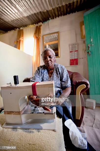 Woman sewing at home in Gugulethu, Cape Town, South Africa.