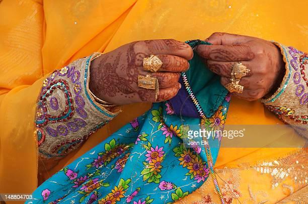 Woman sewing, detail.